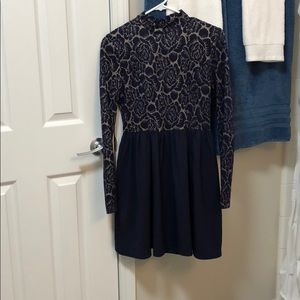 Navy blue and gold long sleeve open back dress